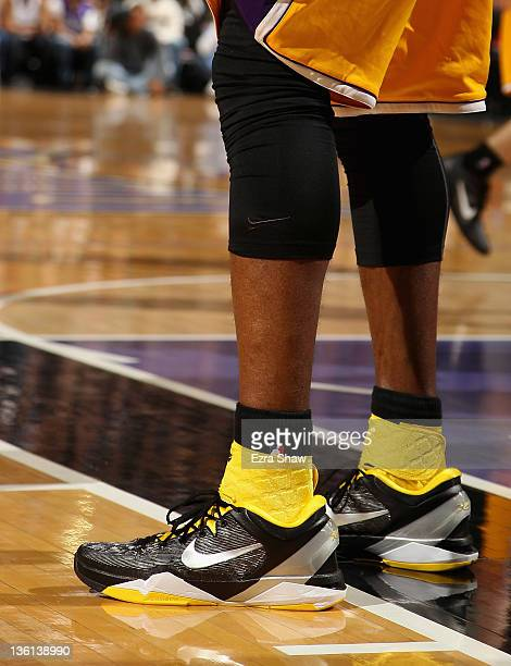 A close up of the shoes worn by Kobe Bryant of the Los Angeles Lakers during their game against the Sacramento Kings at Power Balance Pavilion on...