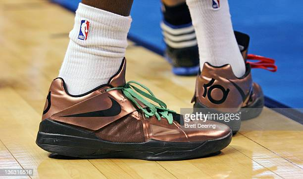 A close up of the sneaker worn by Kevin Durant of the Oklahoma City Thunder with holiday themed shoe laces against the Orlando Magic during the NBA...