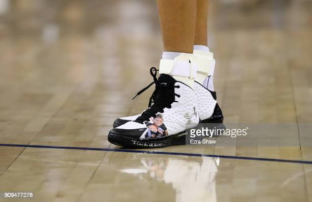 A close up of the sneakers worn by Stephen Curry of the Golden State Warriors witha picture of his childre Ryan and Riley on them during their game...