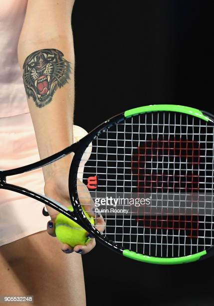 A close up of the tattoo on Aryna Sabalenka of Belarus' arm as she prepares to serve in her first round match against Ashleigh Barty of Australia on...