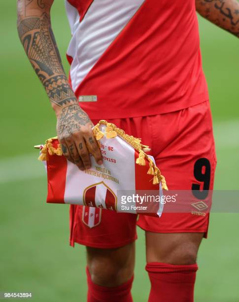 A close up of the tattoo's of Peru player Paolo Guerrero in action during the 2018 FIFA World Cup Russia group C match between Australia and Peru at...