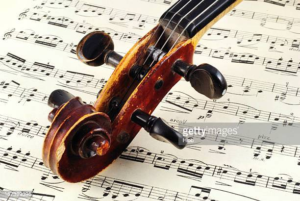 close up of the top of a violin on a music sheet - beethoven stock pictures, royalty-free photos & images