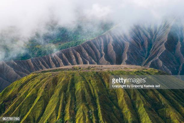 Close up of the volcano ridges of Batok and Bromo volcanoes with fog in the morning,  Indonesia.
