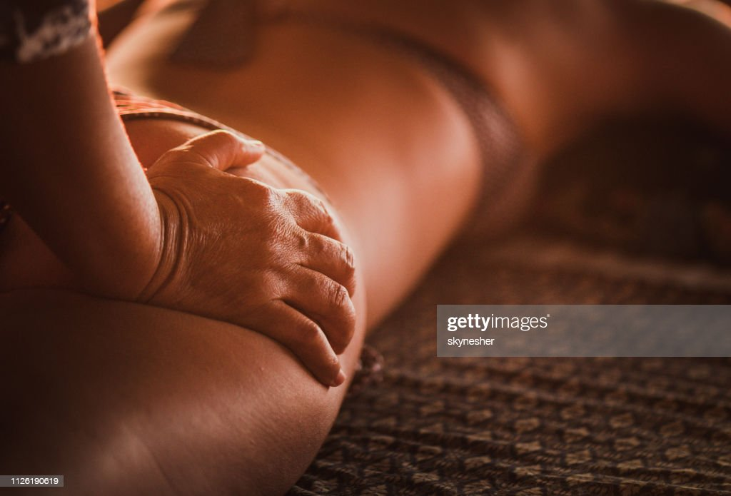 Close up of therapist giving shiatsu massage to her customer. : Stock Photo