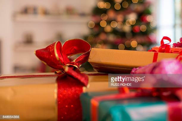Christmas present stock photos and pictures getty images close up of three christmas gifts with ribbons negle Choice Image
