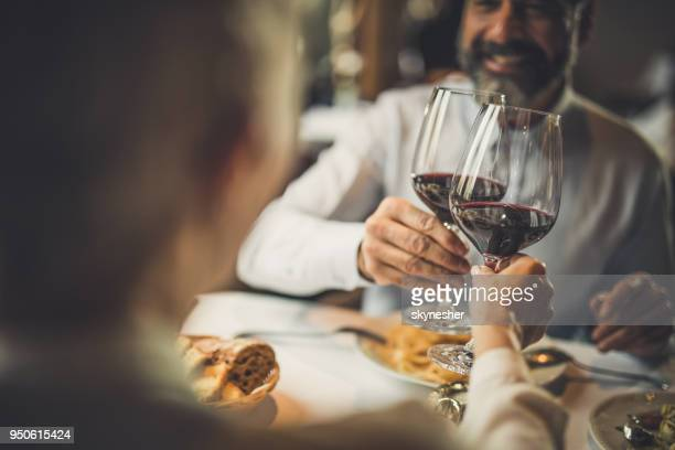 close up of toasting with wine in a restaurant! - bere foto e immagini stock