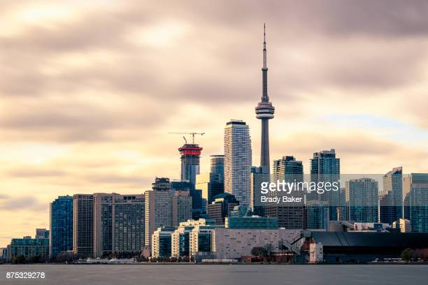 close up of toronto city skyline with dramatic sky near sunset - toronto ontario canada fotografías e imágenes de stock