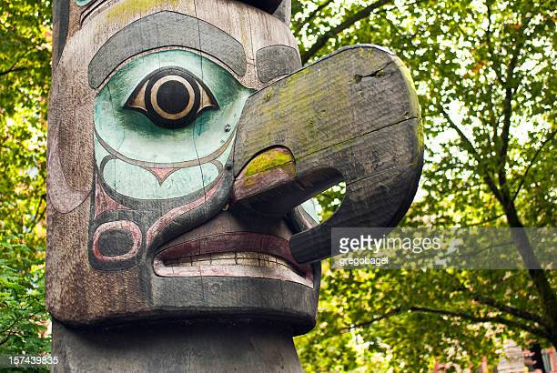 close up of totem pole in pioneer square - totem pole stock photos and pictures