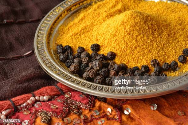 Close Up Of Turmeric With Black Peppers In Plate