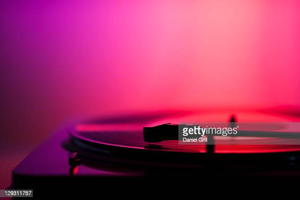 Close up of turntable on pink background