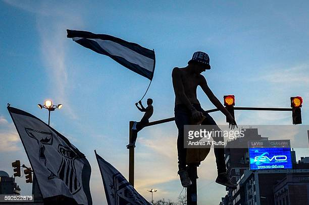 Close up of two fans of the football team Talleres de Córdoba semaphore up during the victory celebrations in the center of the city of Cordoba...