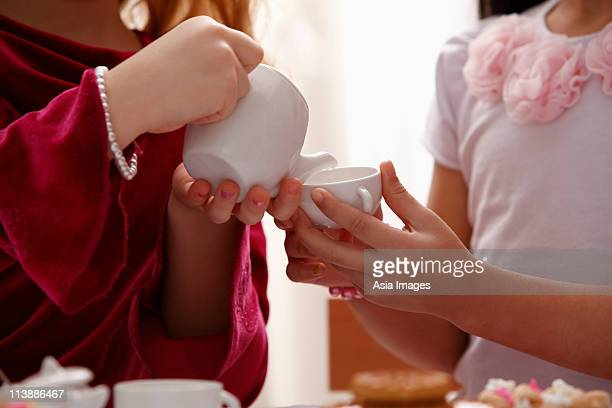 close up of two girls playing tea party