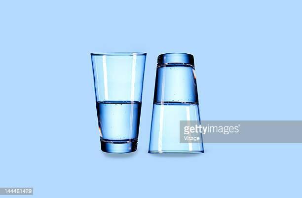 close up of two glasses - half full stock photos and pictures