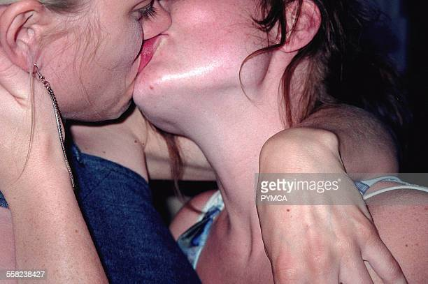 Close up of two lesbian girls kissing Barcelona 2002