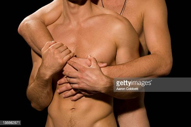 Close up of two men embracing