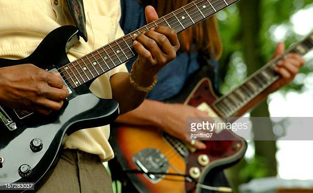 close up of two people playing guitars - blues music stock pictures, royalty-free photos & images
