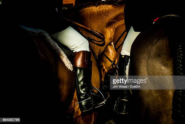 close up of two people riding horses - dressage stock pictures, royalty-free photos & images