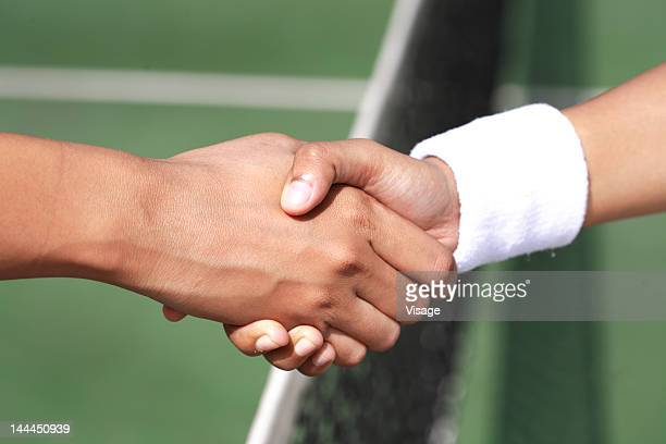 Close up of two people shaking hands
