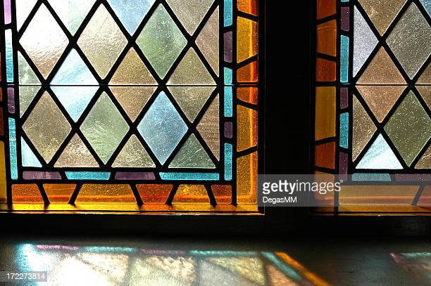 a close up of two stained glass windows - stained glass stock photos and pictures