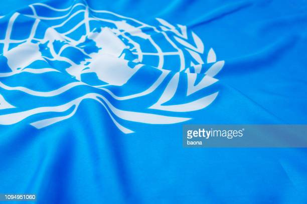 close up of united flags - ambassador stock pictures, royalty-free photos & images
