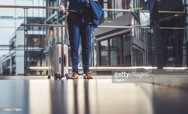 close up of unknown man going to vacation. - luggage stock pictures, royalty-free photos & images
