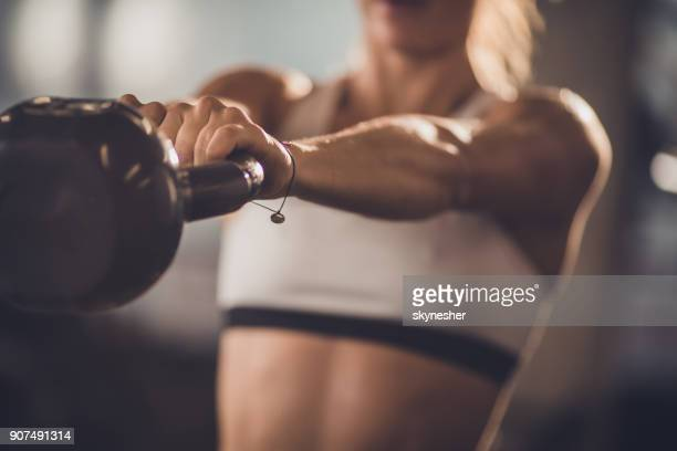close up of unrecognizable athlete exercising with kettle bell. - strength training stock pictures, royalty-free photos & images