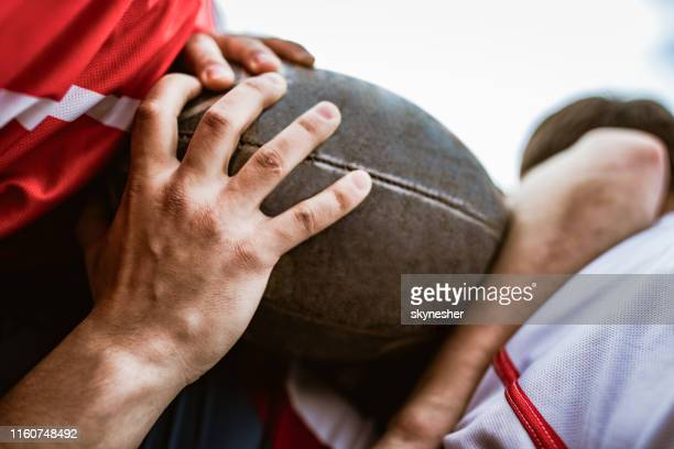 close up of unrecognizable athletes during rugby match. - rugby union stock pictures, royalty-free photos & images