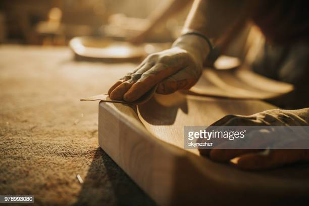 close up of unrecognizable carpenter restoring a wood with sand paper. - craftsman stock photos and pictures