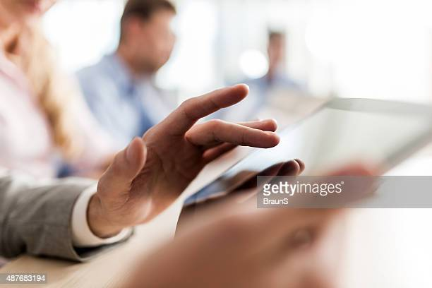 close up of unrecognizable person using digital tablet. - elektronische organiser stockfoto's en -beelden