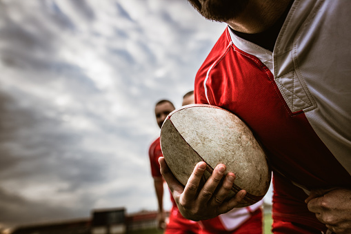 Close up of unrecognizable rugby player with ball. 1147316254