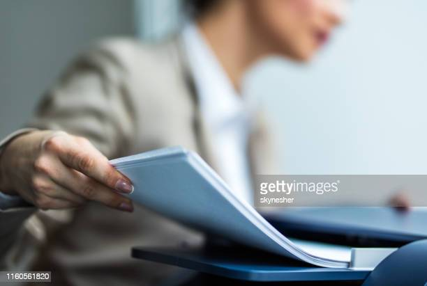 close up of unrecognizable secretary working on copy machine. - printing out stock pictures, royalty-free photos & images