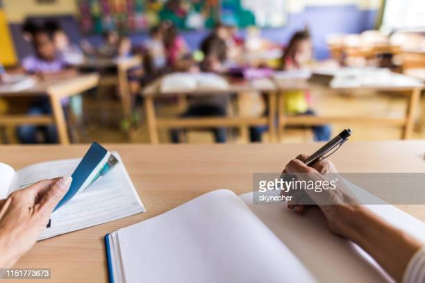 close up of unrecognizable teacher taking notes on a class. - elementary school stock pictures, royalty-free photos & images
