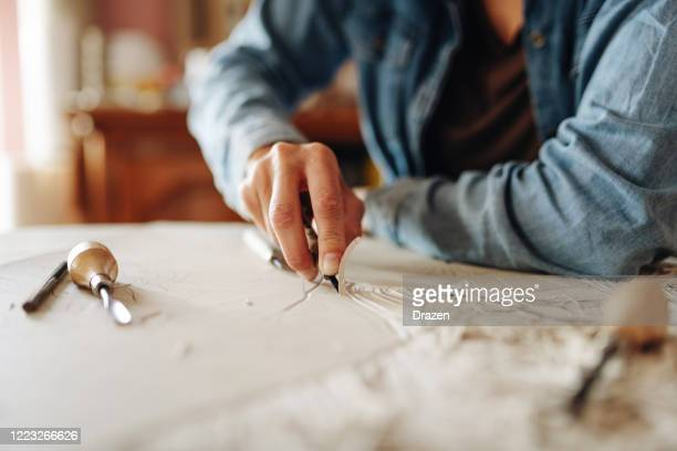 close up of unrecognizable woman doing linocut technique with copy space - graphic print stock pictures, royalty-free photos & images
