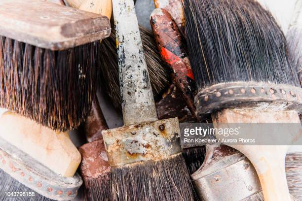 close up of used paintbrushes - koeberer stock photos and pictures