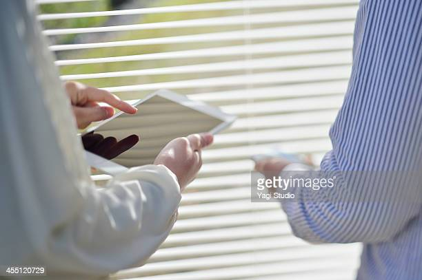 Close up of using digital tablet in meeting