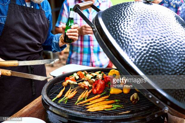close up of vegetables cooking on barbecue - vegetarian food stock pictures, royalty-free photos & images