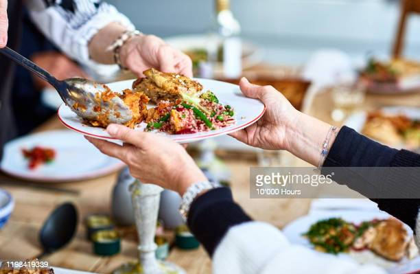 close up of vegetarian food being served on plate - eetklaar stockfoto's en -beelden