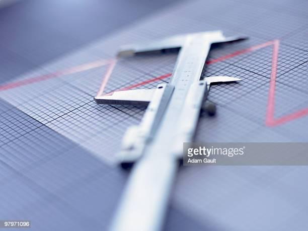 Close up of vernier caliper on graph