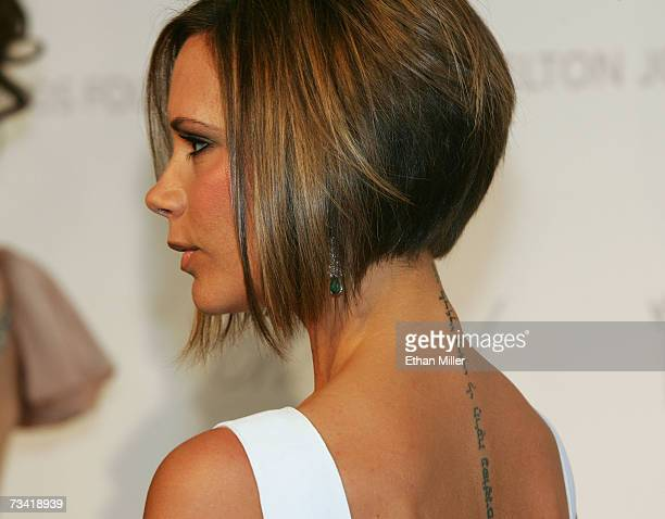 A close up of Victoria Beckham's tattoo is seen as she arrives at the 15th Annual Elton John AIDS Foundation Academy Awards viewing party held at the...