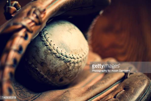 Close up of vintage baseball glove and ball