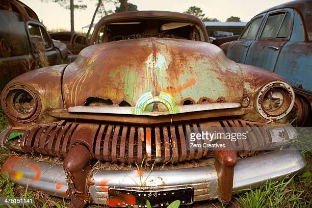 Close up of vintage car in scrap yard