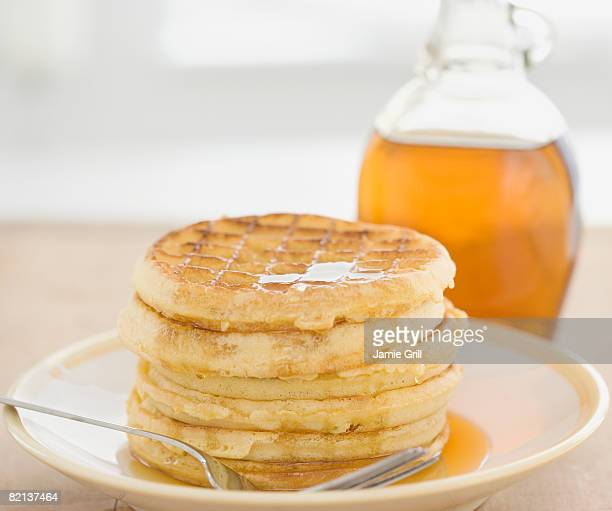 Close up of waffles and syrup