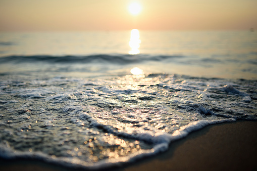 Close up of waves on the shore line of a sandy beach - gettyimageskorea