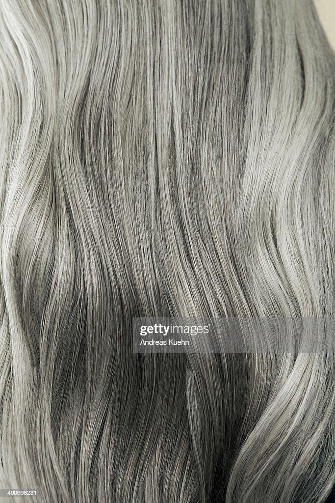 Close up of wavy, long, silver gray hair. : Stock Photo