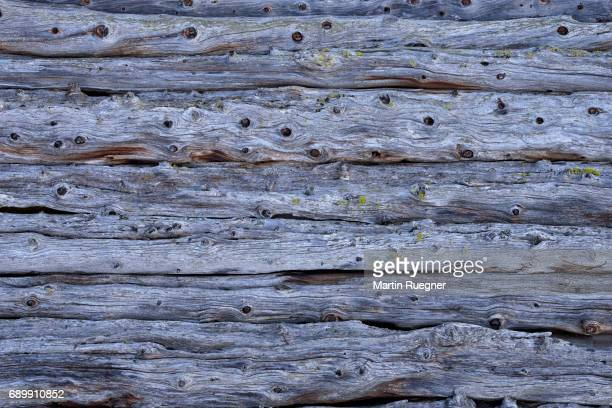 Close up of weathered, wooden boards on mountain hut in the Dolomites.