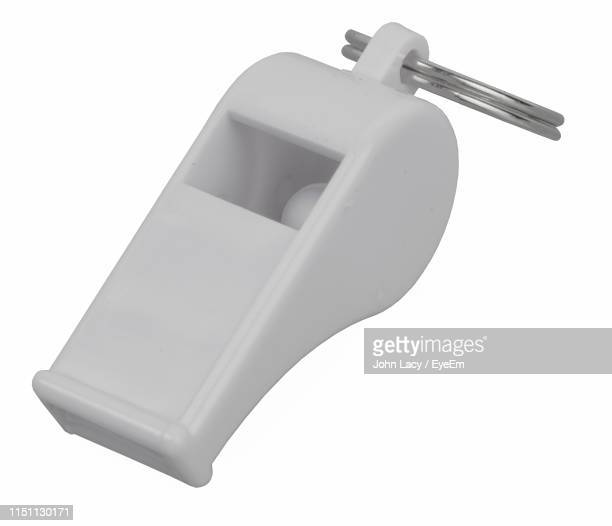 close up of whistle over white background - whistle stock pictures, royalty-free photos & images