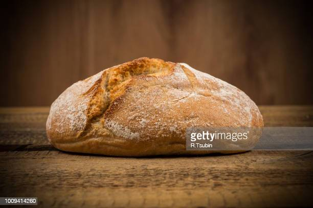 close up of white bread over wooden background - loaf of bread stock pictures, royalty-free photos & images