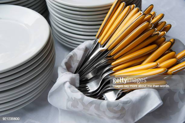 Close up of white dishes and cutlery