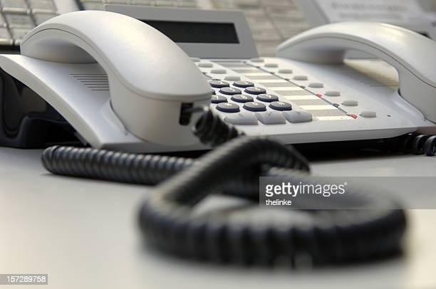 Close up of white landline phone on desk