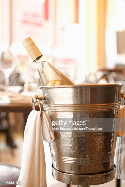 Close up of white wine in ice bucket